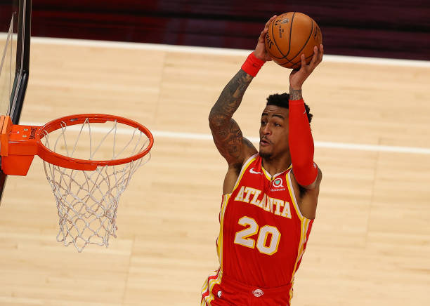 John Collins #20 of the Atlanta Hawks dunks against the Detroit Pistons during the second half at State Farm Arena on December 28, 2020 in Atlanta, Georgia.(Photo by Kevin C. Cox/Getty Images)