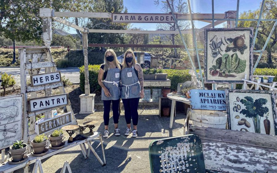 Claire Gallion and Valerie Madeira stand in front of their booth filled with plants and garden accessories on Saturday, February 27 in Thousand Oaks, CA. Photo credit: Valeri Roussak