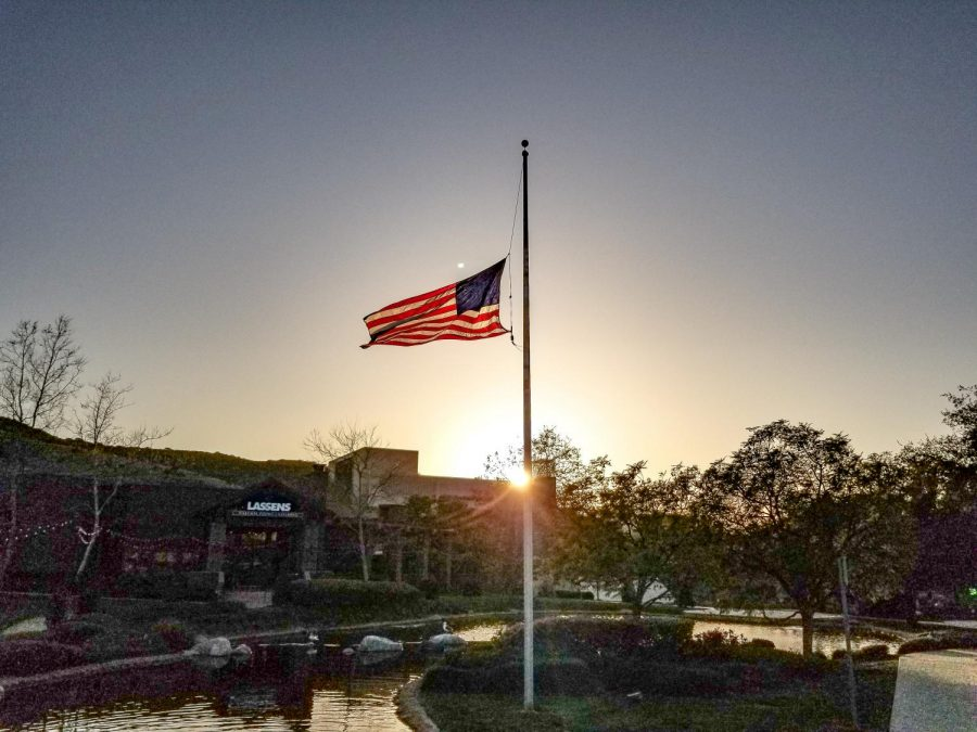 As the sun set on Saturday, March 20, 2021, the American flag flew at half-staff at The Lakes at Thousand Oaks in honor of the Atlanta, GA shooting victims. Next door, at the Thousand Oaks Civic Plaza (seen in the background), a candlelight vigil was organized to honor the eight whose lives were taken as well as to spread the message to racism and discrimination of Asian  Americans. Photo credit: Tara Brown