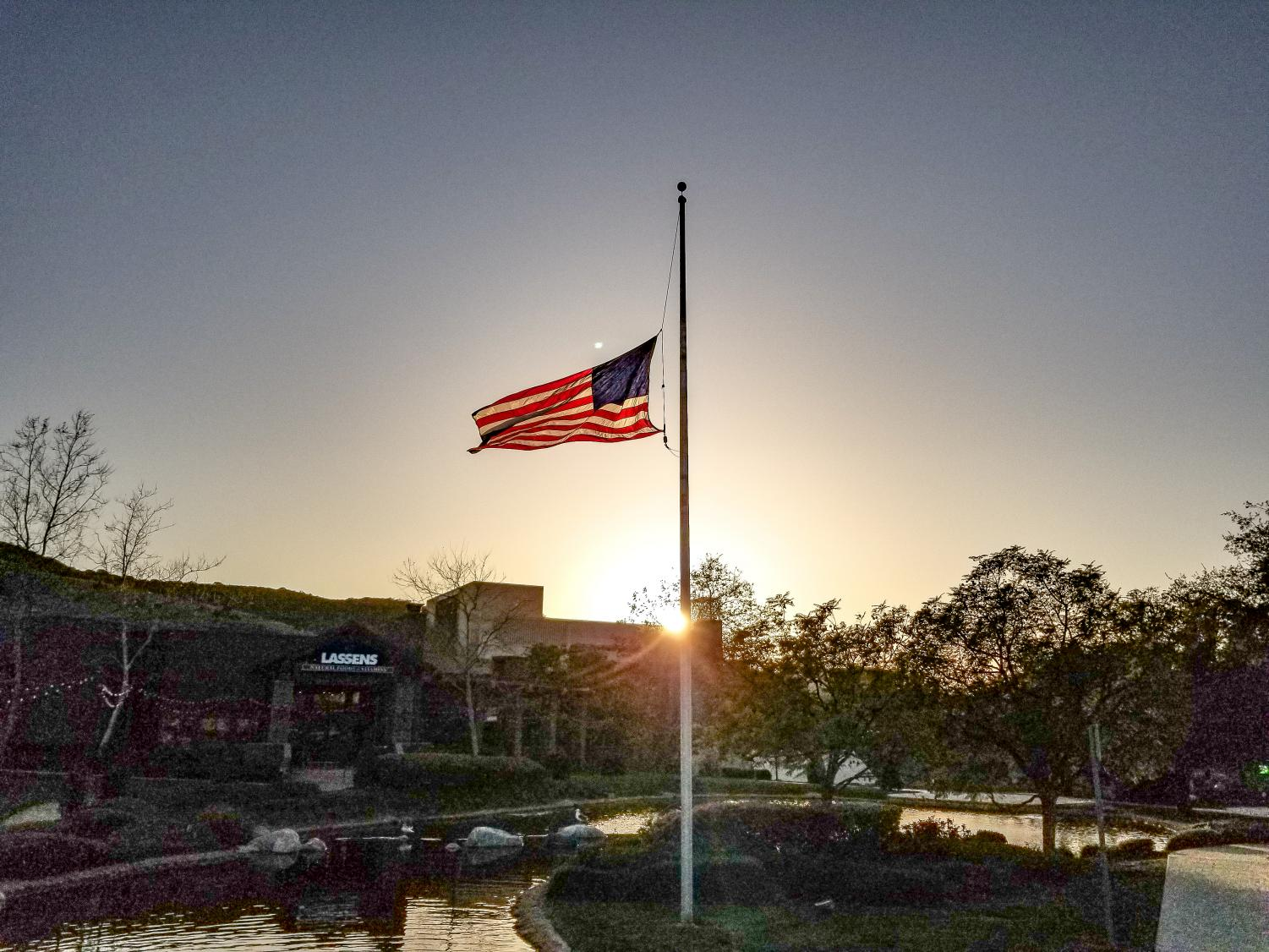 As the sun set on Saturday, March 20, 2021, the American flag flew at half-staff at The Lakes at Thousand Oaks in honor of the Atlanta, GA shooting victims. Next door, at the Thousand Oaks Civic Plaza (seen in the background), a candlelight vigil was organized to honor the eight whose lives were taken as well as to spread the message to racism and discrimination of the Asian community.