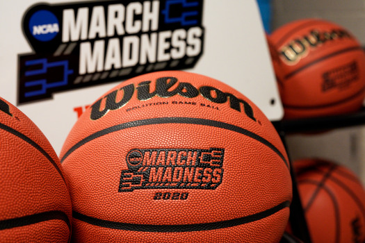In this March 16, 2020, file photo, official March Madness 2020 tournament basketballs are displayed in a storeroom at the CHI Health Center Arena, in Omaha, Neb. (AP Photo/Nati Harnik)