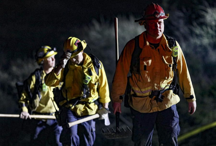 Ventura County firefighters return to their vehicles after successful stopping the Westwood Fire in Simi Valley, CA. on Sunday, April 4, 2021. The Westwood fire grew to 25 acres before forward progress was stopped. Photo credit: Ryan Bough