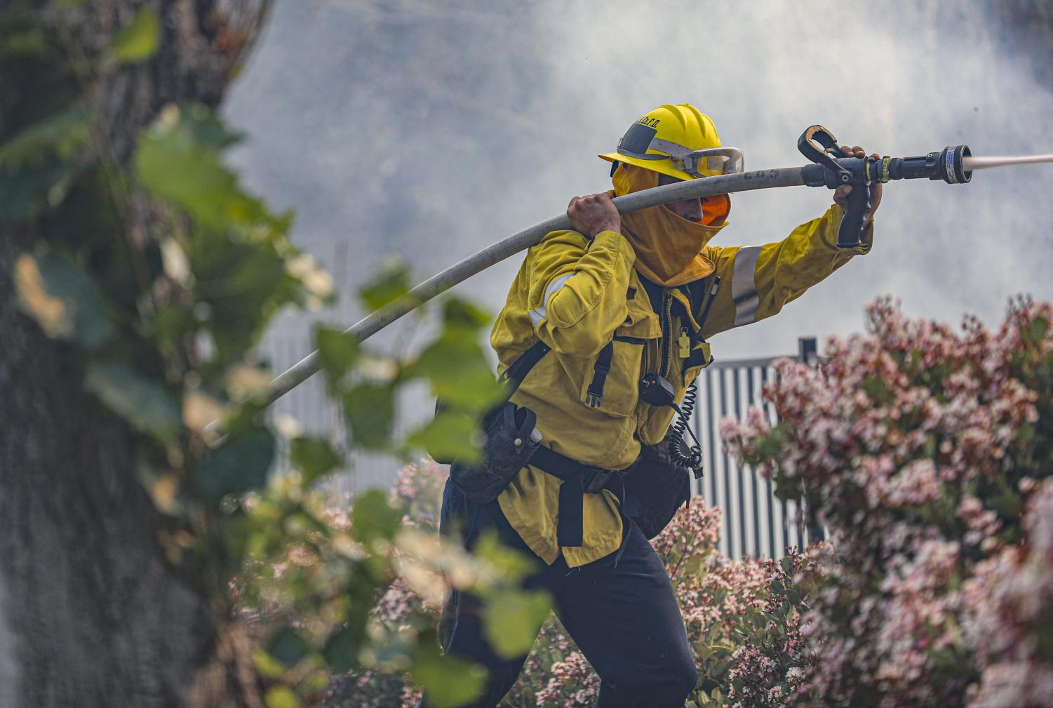 A Ventura County Firefighter works to extinguish a flare up from the Country Fire in Thousand Oaks, CA. on April 29, 2021.