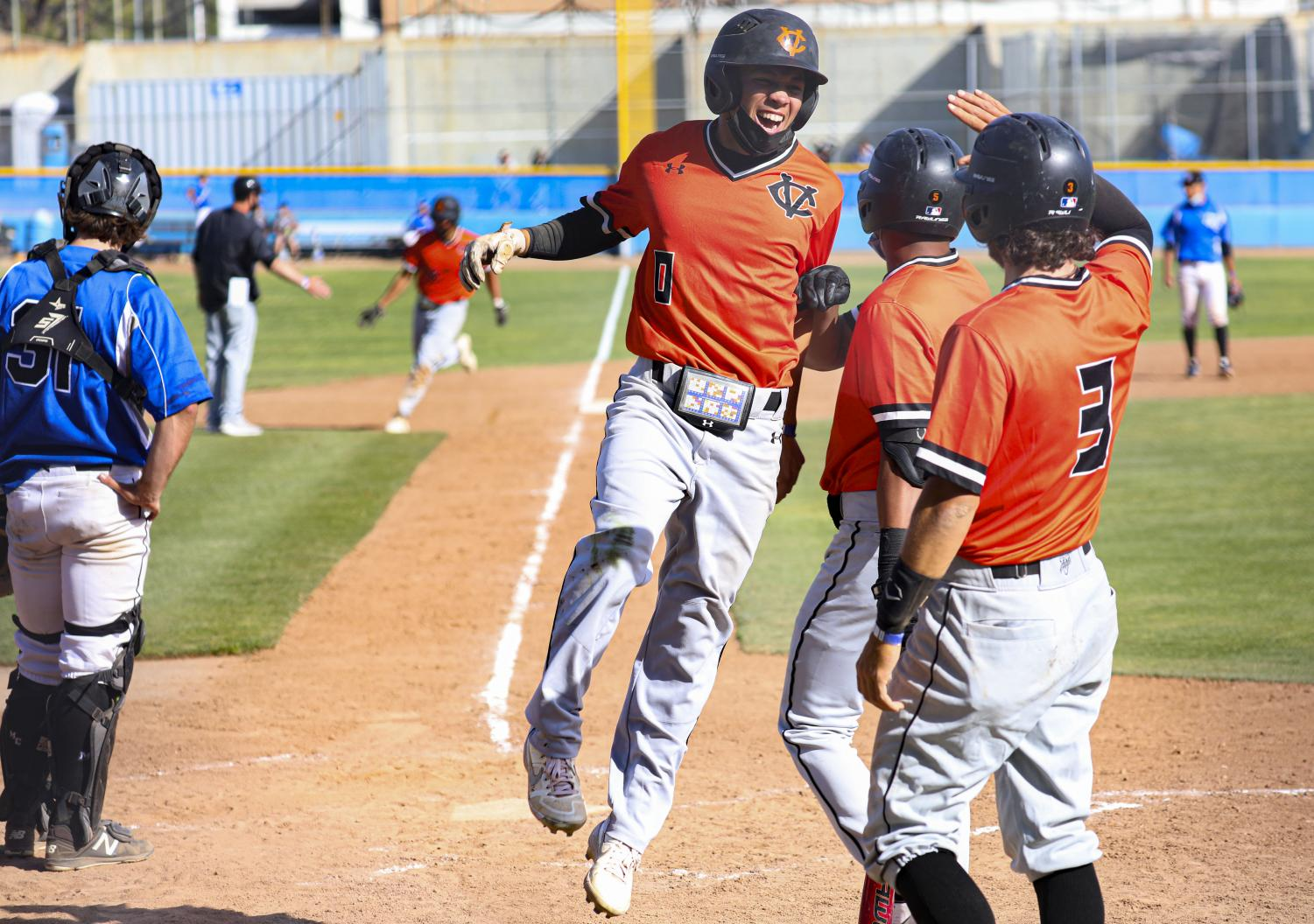 Ventura Pirate JR Godinez celebrates with his teammates at Homeplate after scoring a run