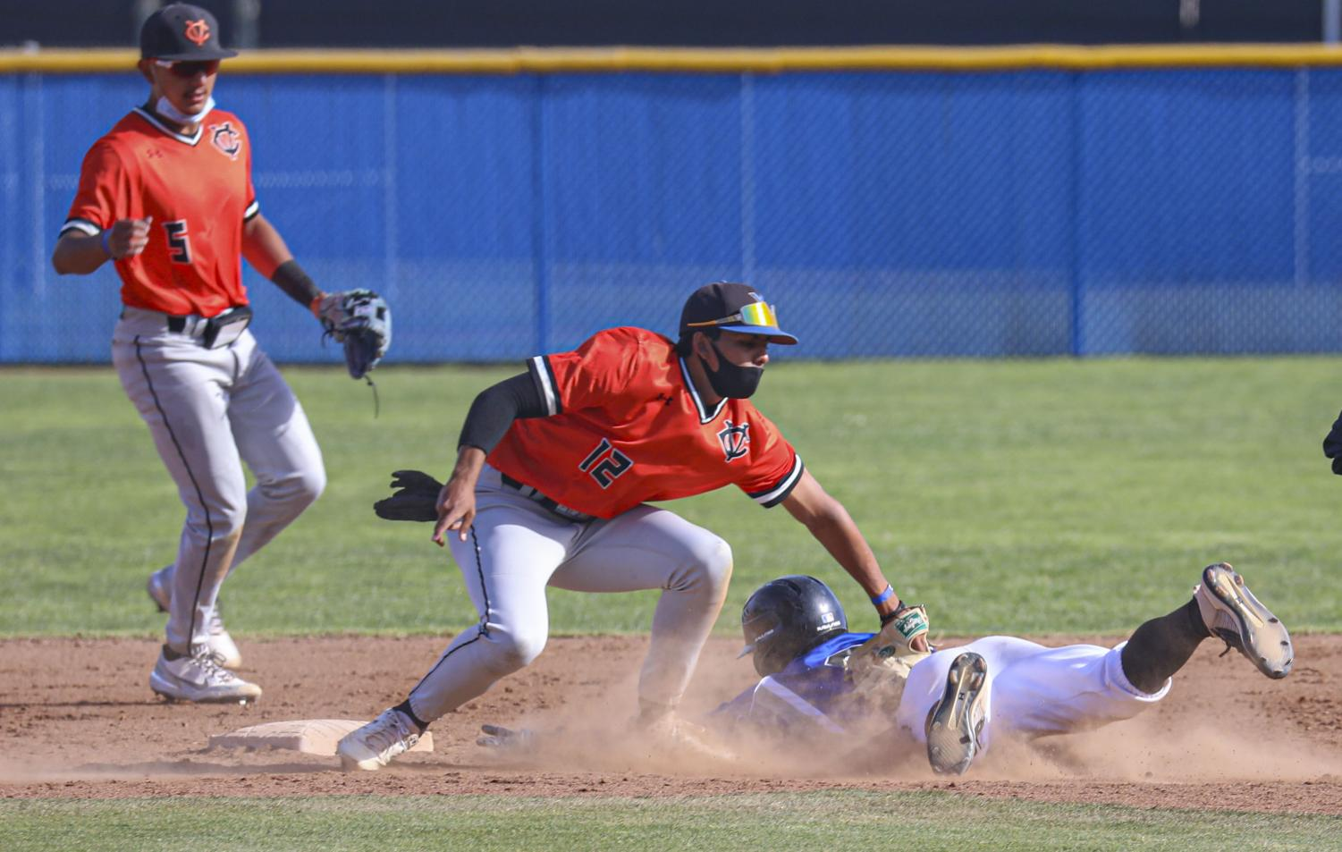 Moorpark Raider Nate Martinez attempts to slide into second base as Ventura Pirate Chase McBean tags him out during the second game of the doubleheader on Thursday, April 15, 2021 during the home against Ventura College at Moorpark, CA.