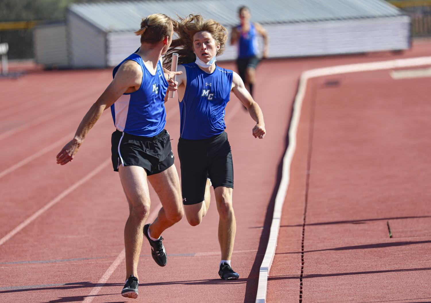 James Boss passes the baton to Zach Leith during the 4x400 meter relay at the first WSC meet of the season on Friday, April 16, 2021 in Moorpark, CA.