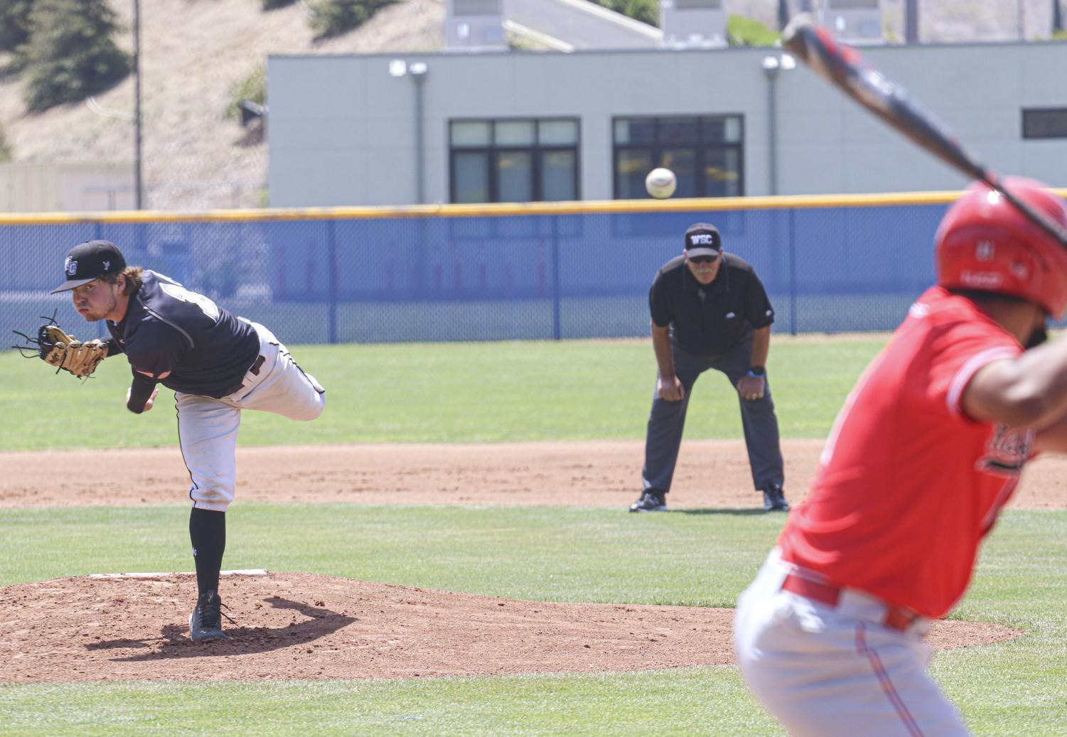 Moorpark Raider's freshman pitcher Noah Balandran delivers a pitch against the visiting Bakersfield Renegades on May 8, 2021.