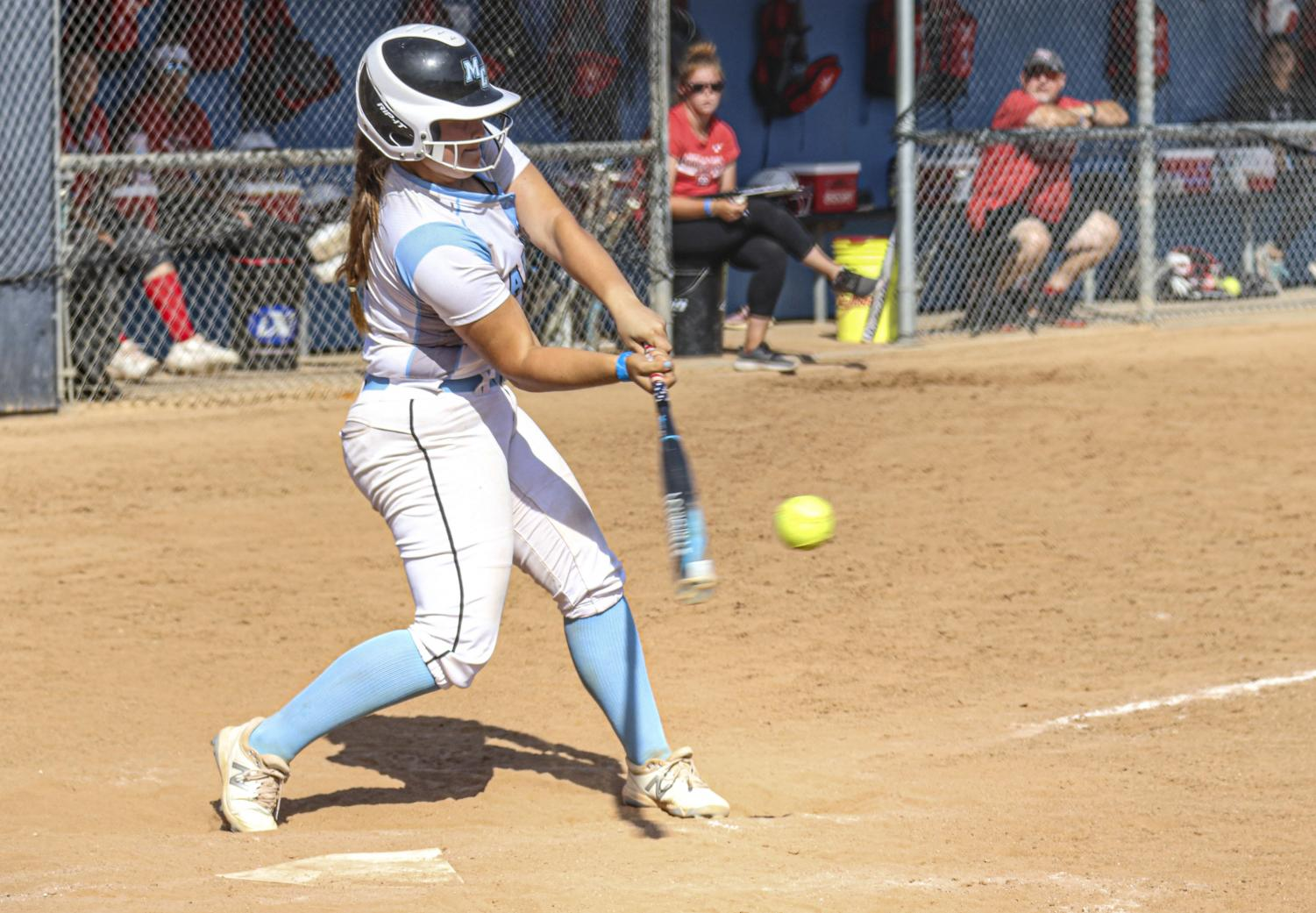 First baseman Ylse Prieto makes contact with a pitch during Moorpark's second home game of a doubleheader versus Bakersfield College on Saturday, May 8, 2021.