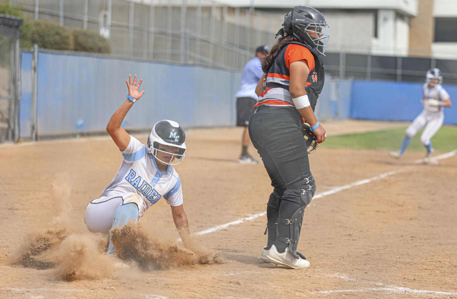 Moorpark Raider __________ slides into home plate, scoring a run for the Raiders during the home game against Ventura College on Saturday, May 1, 2021 in Moorpark, CA.