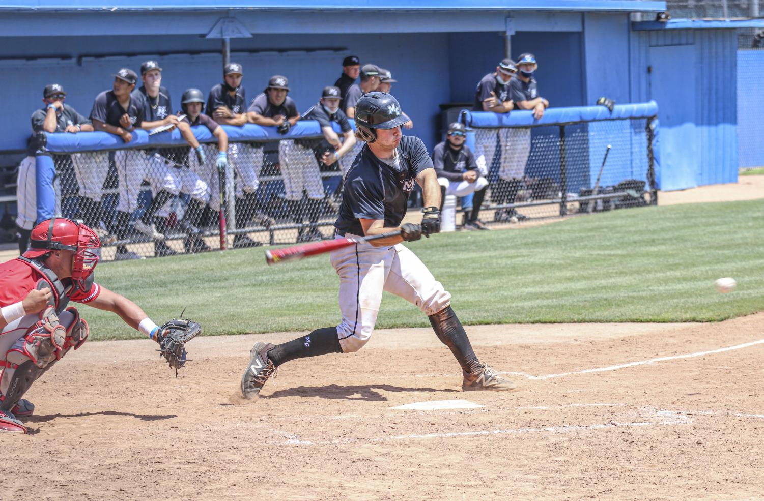 Moorpark's freshman catcher Robert Rehman swings at a pitch during the Raider's home game against Bakersfield College on Saturday, May 8, 2021.
