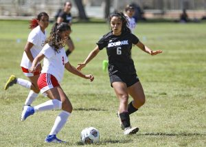Moorpark Raider Natalie Tapia (right) moves to block Veronica Saavedra during the home game against Imperial Valley on Friday, Aug. 27 in Moorpark, CA. Moorpark defeated Imperial Valley 4-0 in their season opener. Photo credit: Ryan Bough