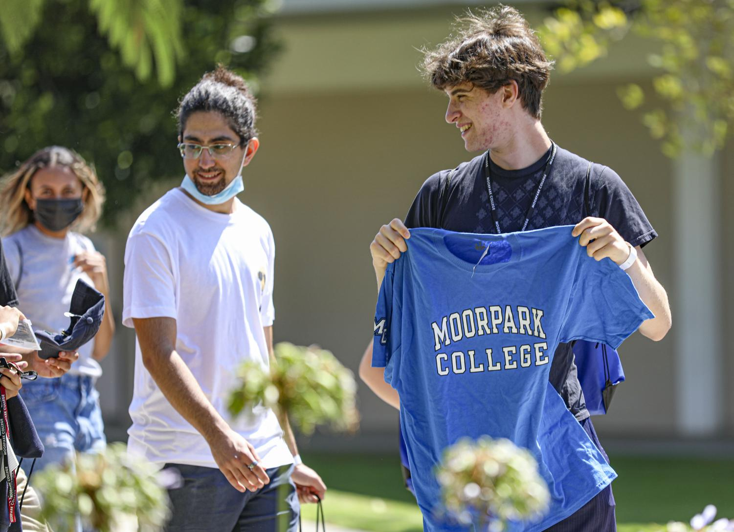 Giovani Long holds up a 'Moorpark College' t-shirt during a guided tour of campus at the New Student Welcome on Monday, Aug. 9, 2021 at Moorpark College, CA.